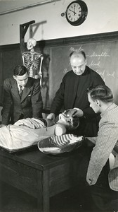 Anatomy laboratory with priest and students