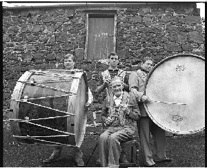 The Brownlees Family with Lambeg drum. Three generations from Ballymena, members of the Orange order, who play flutes and Lambeg drums, wearing Orange sashes