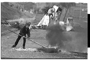 Children burn tyre and block Flying Horse Road, Downpatrick, Co. Down, anniversary of internment year different to items 22-25