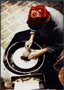 View of person crafting item at pottery wheel