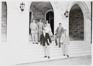 Boston College students pose for portrait on the steps of a campus building