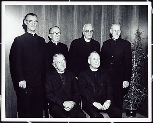 Group portrait of clergy. Fr. Michael Walsh seated on right.