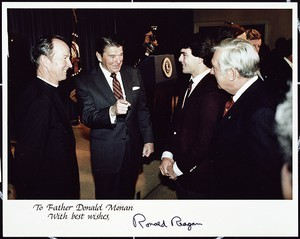 "Fr. Monan, Pres. Reagan, Doug Flutie, and ___. Photo is signed by Ronald Reagan: ""To Father Donald Monan. With best wishes, Ronald Reagan"""