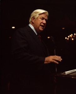 Thomas P. O'Neill speaking at a microphone, gesturing with hand