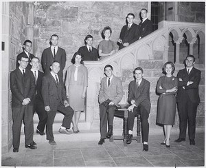 Boston College students pose for portrait in the Ford Tower at Bapst