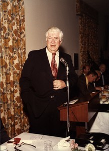 Thomas P. O'Neill speaking at a microphone, hand in pocket