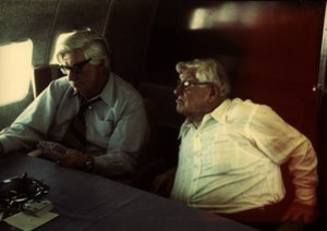 Thomas P. O'Neill playing cards on the airplane with unidentified man