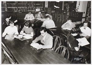 View of students studying in library at Boston Evening College