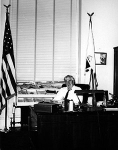 Thomas P. O'Neill sitting at desk in congressional office
