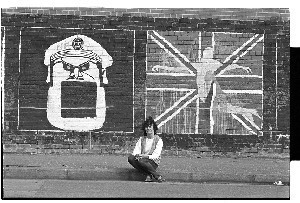 Gerry Adams, President of Sinn Fein, and Mairead Corrigan, co-founder of the Peace People, in front of a Sinn Fein republican wall mural on the Falls Road, Belfast