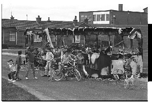 Burnt-out vehicles at Flying Horse Estate, Downpatrick after night of rioting on the anniversary of internment
