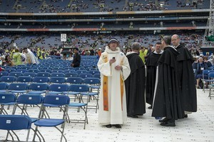 2012 50th International Eucharistic Congress, Final Day Ceremony, 17th June, at Croke Park GAA Stadium, Dublin. Shots of different sections of the crowd including pilgrims, groups of nuns; bishops and clergy, volunteers, stewards, garda siochana (police), eucharistic ministers; also the altar on a large stage with the main celebrant the Papal Legate, His Eminence Marc, Cardinal Ouellet and the concelebrants