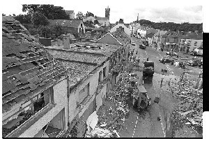 Damage from bomb in Main Street, Ballynahinch, Co. Down, caused by PIRA. Shots taken next day showing damage to surrounding property