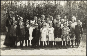 Co-ed grammar school class in a field