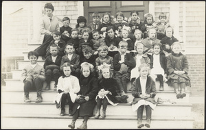 Co-ed grammar school class; one peeking out of cellar window