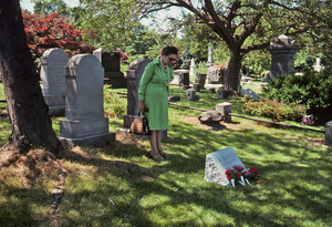 Visitor at the grave of E. Alice Austen