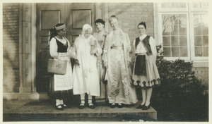 Women in costume on doorstep