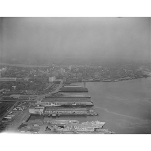 South Boston Harbor area and docks, United States Navy ships, front, then Fish Pier and Commonwealth Pier, Boston, MA