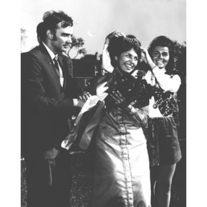 1969 Homecoming Queen being crowned by last year's queen and handed roses