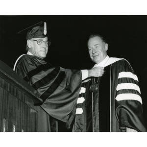 Chairman Willis bestows the University's presidential laveliere on Kenneth g. Ryder