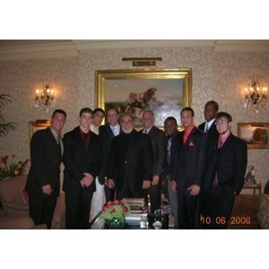Several men associated with the Torch Scholars program pose together in Washington D.C