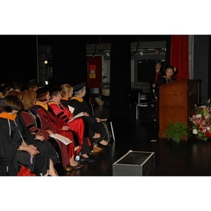 Students and faculty members from the School of Nursing seated on the stage during convocation