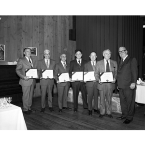 25 Year Association inductees pose together with their certificates and Asa Knowles