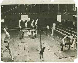 Gymnasts practicing in Judd Gymnasium