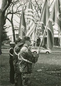 Four Soldiers with Flags on Veteran's Day