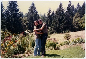 Love Sandwich: Mark and Sandi Sommer with Chewie in between, on lawn, Salmon Creek