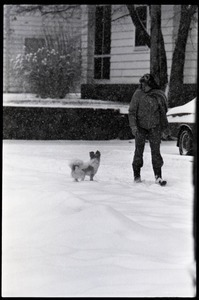 Woman walking her dog in the snow