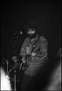 Grateful Dead performing at the Music Hall: Jerry Garcia onstage, playing guitar