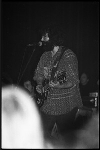 Grateful Dead performing at the Music Hall: Jerry Garcia onstage, playing guitar and singing