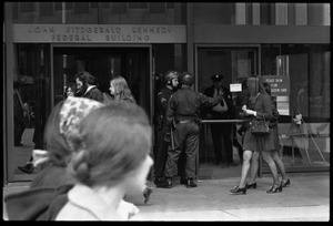 Antiwar protesters picketing the entrance to the John F. Kennedy Federal Building as police stand by