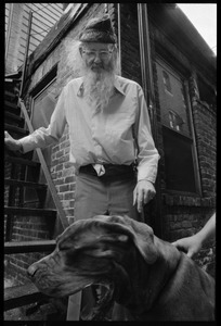 Prescott Townsend with a large dog in a Beacon Hill alley
