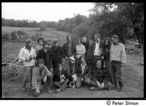 Group portrait of members and friends of Packer Corners commune standing around outside the house