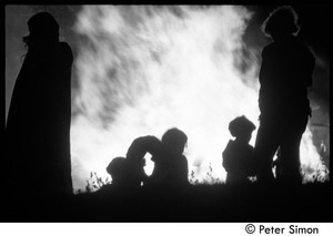 After the Maypole celebration, Packer Corners commune: silhouette and bonfire
