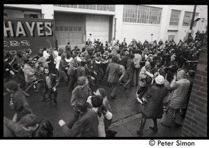 Antiwar demonstration at MIT's Draper Instrumentation Laboratories: police in riot gear with batons ready descend on protesters