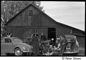 Commune members gathered around their vehicles outside the barn, Packer Corners commune