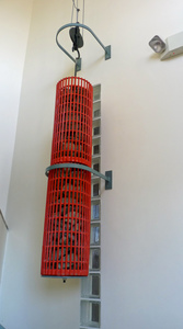 Paige Memorial Library: weight suspended in a basement stairway