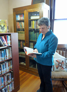 Paige Memorial Library: woman browsing in the reading area