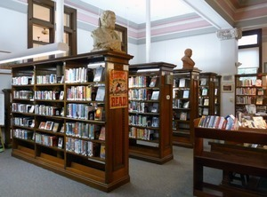 Belding Memorial Library: interior with bookcases and busts