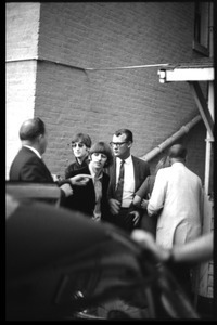 Ringo Starr and John Lennon heading to a limousine