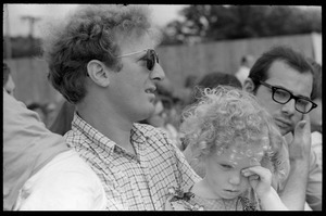 Father and infant daughter in the audience, waiting to see Taj Mahal in concert, Newport Folk Festival