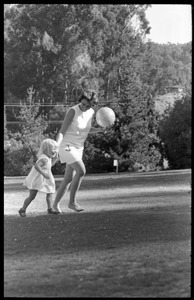Woman and child playing on Cambridge Common