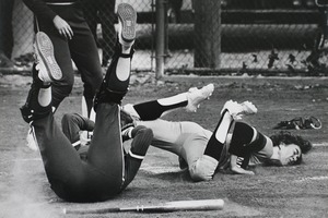 Collision at home plate in a softball game