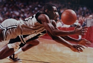 Basketball players from Providence College and Georgetown scrap for a loose ball in NCAA tournament