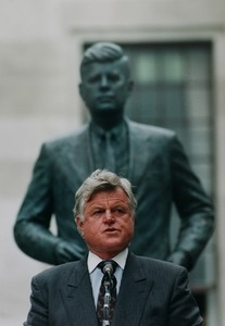 Edward M. Kennedy in front of statue to John F. Kennedy
