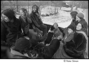 Riding the back of a pickup truck: (l.-r.) Bonnie Fisher, Lacey Mason, Elliot Blinder, Tim Rossner, Jenny Rose, Catherine Blinder, and Peter Simon petting a dog with his back to the camera