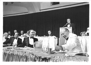 """Walter Mondale at the podium of a political event at the Washington Hilton with Congressmen John Joseph Moakley and Thomas P. """"Tip"""" O'Neill, 1980s"""